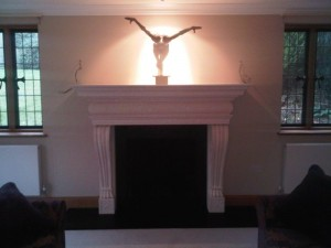 Large limestone fireplace installation in Surrey final