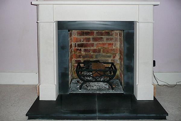 Limestone fireplace surround in Grayshott