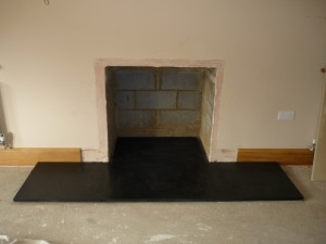 Slate hearth fitted for large fireplace installation in Surrey