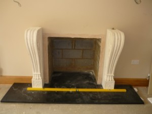 Mantel being assembled for large fireplace installation in Surrey