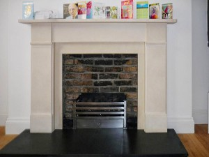 Limestone fireplace with Amhurst fire basket from Chesney's
