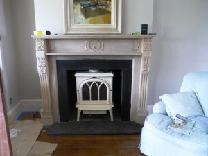Ivory Huntingdon Stove by Stovax in hallway with new hearth and slips in slate