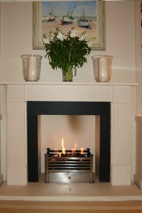 Elegant limestone fireplace with remote control fire