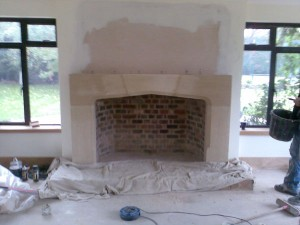 Large Tudor Limestone Fireplace installation in Guildford