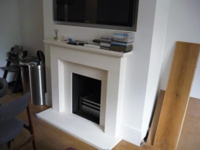 Limestone Fireplace With Polished Basket