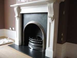 Maida vale fireplace installation. The Buckingham fireplace with ornate arch insert.