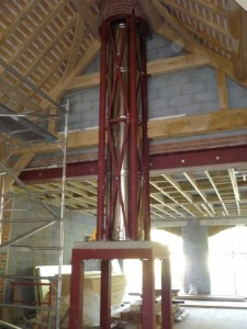 Steel frame installation with flue for bathstone fireplace