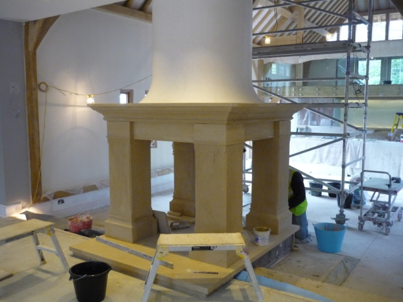 Bathstone fireplace installation in a barn conversion for Four sided fireplace