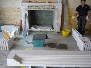 Stone fireplace in Chobham being installed in barn conversion