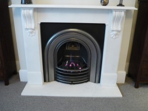 Victorian corbel fireplace with arched cast iron insert