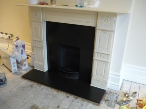 Fireplace Refurbishment in Wimbledon - honed black slate