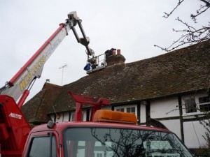 Cherry picker for Jotul Stove in Cranfield installation