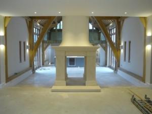 Barn conversion bathstone fireplace