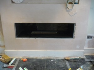 Black Granite Hole in the Wall Fireplace