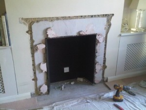 Removal of old fireplace before modena limestone fireplace