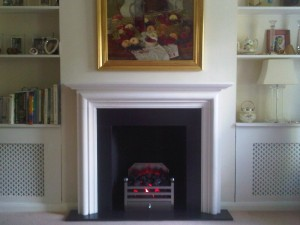 modena limestone fireplace with Elan basket and electric fire