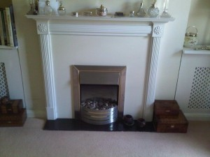 Existing fireplace before modena limestone fireplace installation