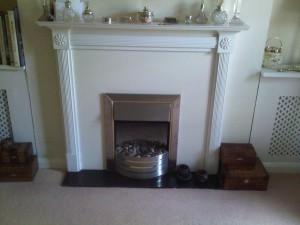Existing fireplace before modena limestone fireplace installation
