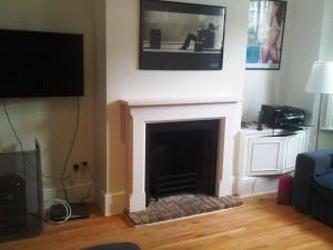 Sienna Limestone Fireplace with basket