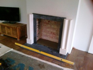 Bolection limestone fireplace