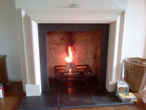 Bolection limestone fireplace with Morris basket from Chesney's