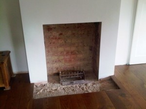 Before Bolection limestone fireplace with Morris basket from Chesney's installation
