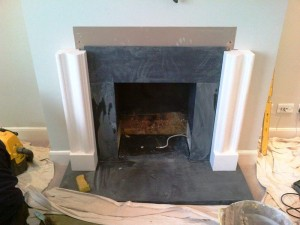 Limestone Bolection fireplace: being installed