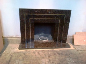 Granite Art Deco Fireplace: trims installed