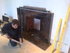 Stunning Granite Fireplace: Landing fireplace being installed