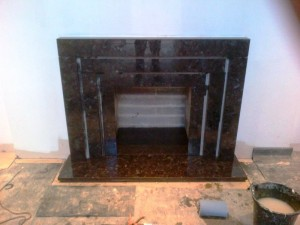 Stunning Granite Fireplace: Landing fireplace nearing completion