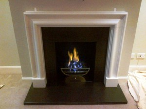 Limestone bolection fireplace with Morris basket