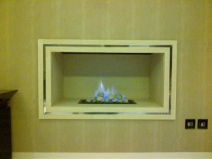 Limestone hole in the wall fireplace with F500 gas fire from Nu Flame with trim
