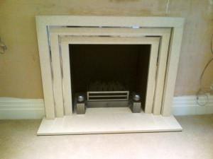 Limestone stepped fireplace: Living Room fireplace