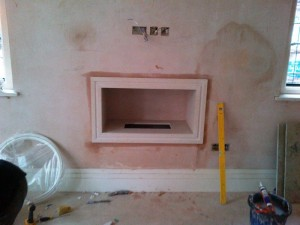 Limestone Hole in the Wall Fireplace: Study fireplace nearing completion