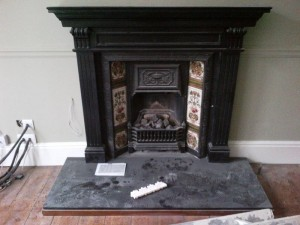 Chesneys Belgravia Gas Stove: original wooden mantel with cast iron insert