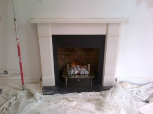 Flat Victorian limestone fireplace with large Zen basket