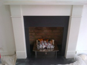 Flat Victorian limestone fireplace with large Zen basket in London
