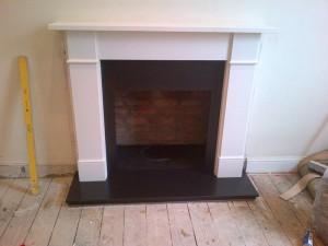 Flat Victorian limestone fireplace installation