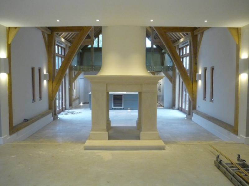 Bathstone fireplace installation complete in barn conversion