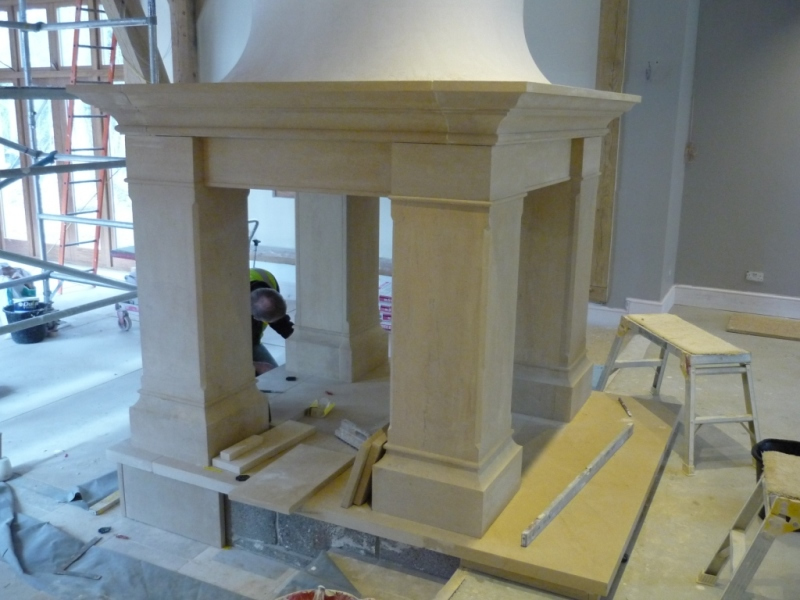 Four sided Bathstone fireplace being fitted