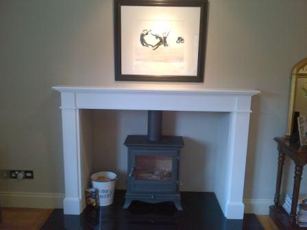Bespoke wooden mantel installation complete