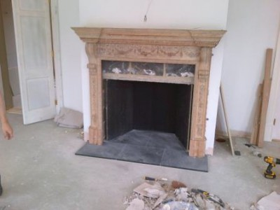 Installing antique wooden mantel into Drawing Room