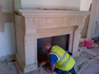 Installing hallway bathstone fireplace