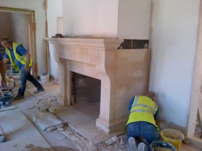 Installing large hallway bathstone fireplace