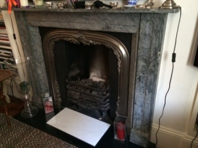 Marble fireplace before removal in Pimlico