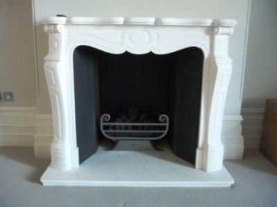 Pompadour marble mantel