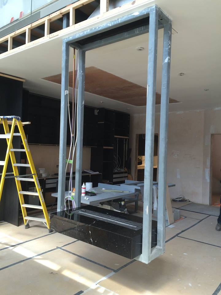 Hanging bespoke fireplace steel frame installation