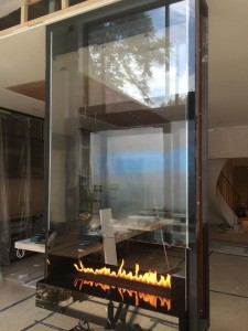 suspended fireplace with glass panels in London