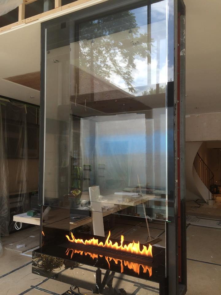 Hanging bespoke fireplace with burner and glass