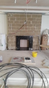 black marble fireplace installation